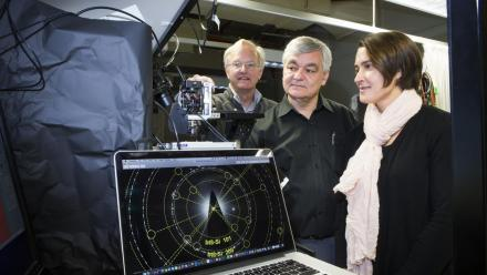 Professor Jim Williams, Professor Andrei Rode and Associate Professor Jodie Bradby with the electron diffraction pattern of one of their new silicon phases. Photo by Stuart Hay.