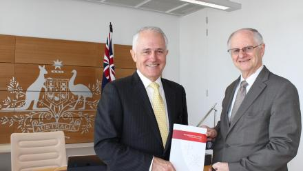 Professor Peter Drysdale presents the report to Prime Minister Malcolm Turnbull