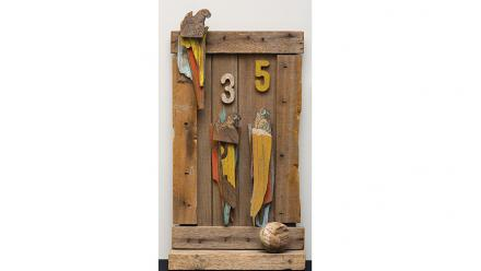 Sideshow Parrots, Rosalie Gascoigne, 1981. Printed cut-out cardboard shapes (Arnott's Biscuits logos) on plywood cut to shape, painted and unpainted wood, painted wood numbers and wooden polo ball. Image courtesy of Bonhams, Sydney.