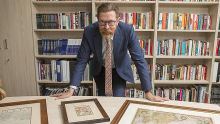 Professor Rory Medcalf with some of his historic Indo-Pacific maps. Photo by Lannon Harley.