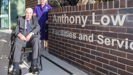 Former ANU Vice-Chancellor Anthony Low in front of the newly-named Anthony Low Building on campus. Photo by Stuart Hay.