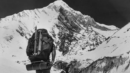 The team setting off towards the south face of Dunagiri in 1978 with the approach route, the Roche Ridge or South West Ridge, on the left.