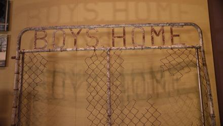 Gate of Kinchela Aboriginal Boys' Home, NSW. Retrieved from the Macleay River circa 1990. Photo by Jason McCarthy, NMA.