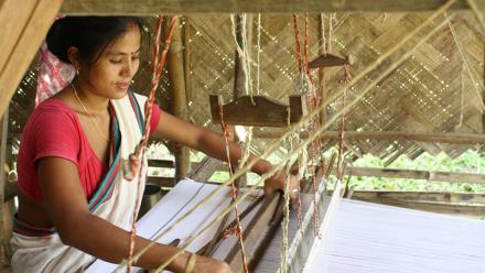 Rekha Doley, a Master Artisan with Impulse Empower, weaving from her home in Assam. Photo: Impulse Social Enterprises.