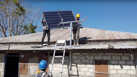 Technicians from a local energy company install Okra Solar panels and meters in a community in Sumba, a remote island in Indonesia.