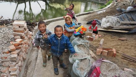 Local children pose in Yunnan. Photo by Tim Williams.