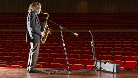 Mr Mackey demonstrating the saxophone stand in Llewellyn Hall. Photo by Stuart Hay.