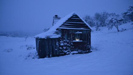 A snow-covered Four Mile Hut, in the Kosciuszko National Park. Photo by Peter Meusburger.
