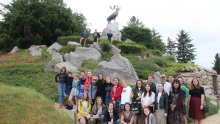 Students gather by the Newfoundland Memorial at Beaumont- Hamel. The caribou is say to be crying out across the battlefield, calling to men lost forever in the battle.