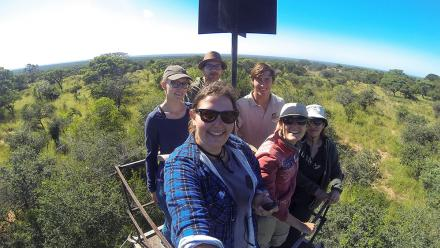 The author, her volunteer group and one of the resident predator monitors on a 15-metre tower to track the wild dog pack.