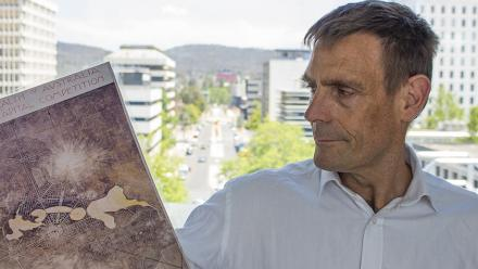 Professor Nicholas Brown with Walter Burley Griffin's plan for Canberra. Photo by Adam Spence.