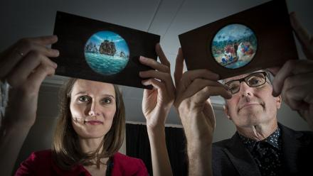 Dr Elisa deCourcy and Dr Martyn Jolly with glass slides for a magic lantern. Photo by Stuart Hay.