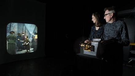 Dr Martyn Jolly and Dr Elisa deCourcy working a magic lantern. Photo by Stuart Hay.