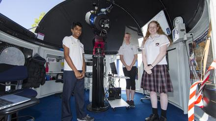 Students with the telescope.