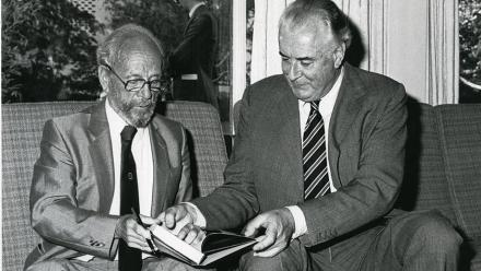 My first assignment: Nugget Coombs signing his book for Gough Whitlam, 1981. Photo by Stuart Hay.
