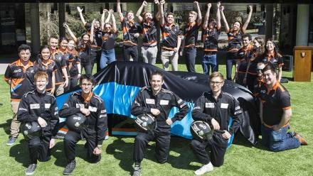 Vice-Chancellor Brian Schmidt unveiling the MTAA Super Charge at ANU; opposite page: team members of the Sol Invictus project. Photos by Stuart Hay. Previous page: The race across the desert. Photo by John Oost.