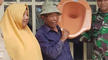 Approximately one-third of homes in rural Indonesia don't have a flushable toilet, and this man is displaying the first toilet to ever be installed in his home in Toepngan village, Central Java