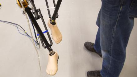 University of Michigan PhD student Brian Buss is continuing work into bipedal robotic walking machines. Photo by Joseph Xu.