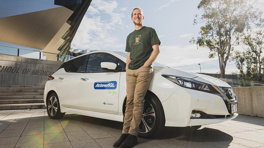 Dr Bjorn Sturmberg with an ActewAGL EV. Photo: Dion Georgopoulos, courtesy of The Canberra Times.