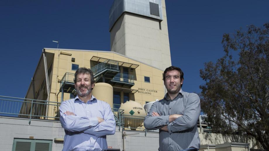 ANU Research School of Chemistry Director Dr John Carver with his son John in front of the John Carver Building.