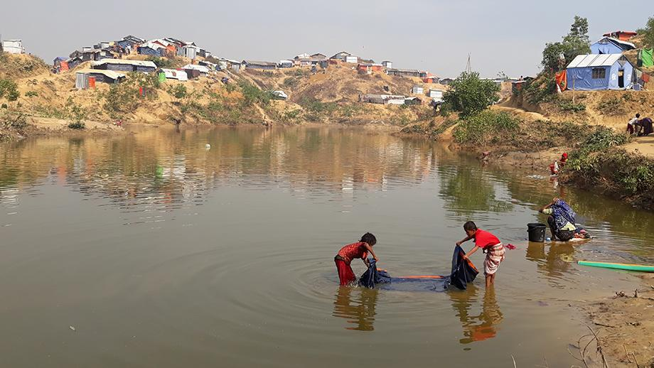 Children washing clothes at Kutupalong refugee camp in Bangladesh. Photo by Dr Bina D'Costa.
