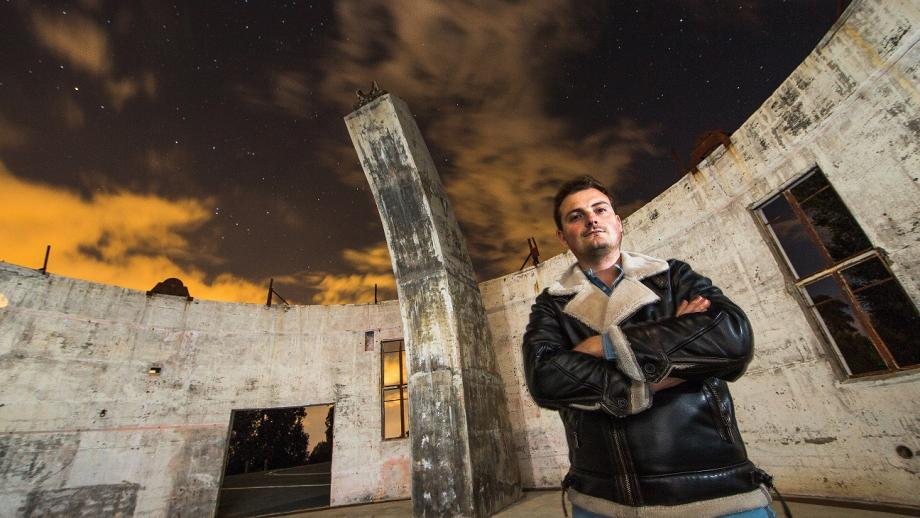 ANU College of Law student Joel Dennerley at the Mt Stromlo Observatory. Photo by Stuart Hay.