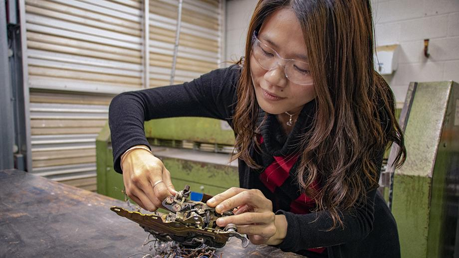 Dr Vi Kie Soo at work with car parts. Photo by Kendall Power.
