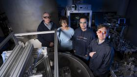 Professor David McClelland, Professor Susan Scott, Dr Robert Ward and Dr Bram Slagmolen, from the ANU Research School of Physics with the TorPeDO, A low-frequency gravitational force sensor. Photo by Lannon Harley.