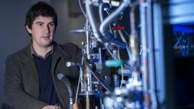 Dr Nick Cox from the ANU Research School of Chemistry with his water -splitting technology. Photo: Lannon Harley