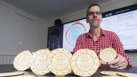 Dr Geoff Hinchcliffe with coasters made from laser-cut wood. Photo by Lannon Harley.