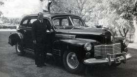 Alfred George Stafford with prime minister Robert Menzies' Commonwealth car, a 1941 Cadillac [licence plate] C1, courtesy of AIATSIS, Alf Stafford Collection, item STAFFORD.A01.DF – D00026157.
