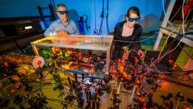 ANU laser physicist Professor Ken Baldwin and PhD student Kate Ferguson. Photo: Stuart Hay