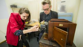 Dr Martyn Jolly and Dr Elisa deCourcy working on a magic lantern. Photo by Stuart Hay.