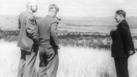 Professors Mark Oliphant, Professor Keith Hancock and Sir Howard Florey (right) looking over the undeveloped university site, 1948.