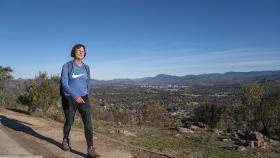 Professor Susan Scott on Mount Taylor in Canberra's south, a walk she does daily after work. Photo by Lannon Harley.