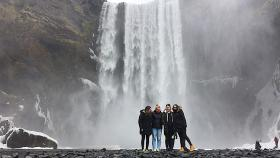 The exchange students at the Skógafoss waterfall on the Skógá River in the south of Iceland. Caity Price is on the left. Photo by Cassidy Rey.