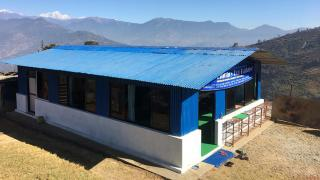 Batase Library, facing the Langtang Himalayan Range. Libraries are more than just a collection of books – they provide a safe place where communities can gather together to develop new skills and fight social inequality.  Photo by Christina Lee.