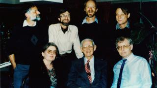 HW Arndt (seated, centre) in the late 1980s, with six of his students (clockwise from bottom left: Anne Booth, Andrew Elek, Howard Dick, Hal Hill, Chris Manning and Peter McCawley).