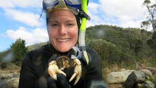 Mae Noble with a crayfish in the Goobarragandra River. Photo supplied.