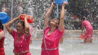 Women celebrate in Yunnan. Photo by Tim Williams.