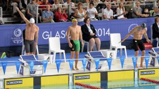 Bachelor of Commerce student Ben Treffers (centre) won gold at the Glasgow Commonwealth Games. Photo: supplied.