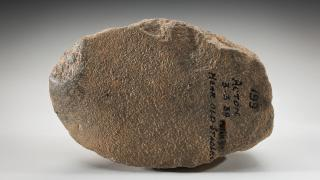 Stone hatchet with ground edges collected at the 'old stables' believed to be on the current site of ANU. Photo by Jason McCarthy, courtesy of the National Museum of Australia.