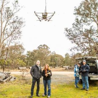 Associate Professor Adrian Manning and Dr Debbie Saunders with a drone. Photo by Stuart Hay.