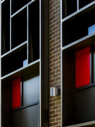 The red and blue corners of the Lotus Hall windows. Photo by Stuart Hay.