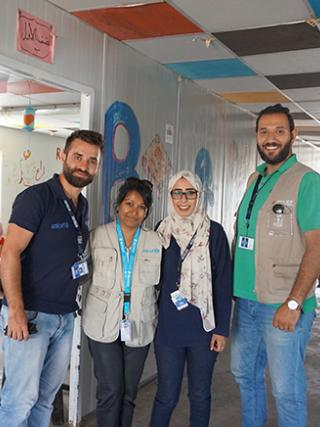 Dr Bina C'Costa with teachers at a Syrian refugee camp in Jordan. UN photo.