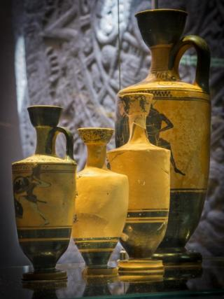 Attic black figure lekythoi, containers for perfumes, dated to the early 5th century BC in Greece. Photo by Stuart Hay.